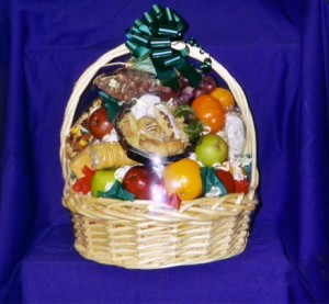 "Fruit Basket #7. The Office/Professional Option 2 $75-100 - This basket is packed with ""Thank You's"" & appreciation from you to your employees or professional associates. You tell us how much you want to spend and we will fill the basket with: cheeses, meats, crackers, our own homemade cookies, candies, chocolates, tangerines, clementines, navel oranges, pears, grapes, and of course our own select apples."