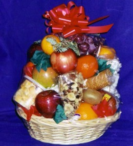 Fruit Basket #8. Snack Tower $50 - A perfect party selection, this basket is strategically balanced with a cheese chunk or snack pack(pre-cut cheese bites), crackers, Troyer Trail bologna, chocolate peanut clusters, yogurt covered pretzels, taffy, chocolate covered raisins, grape fruit, kiwis, clementines, oranges, tangerines, apples and grapes. (26 pieces of fruit.)