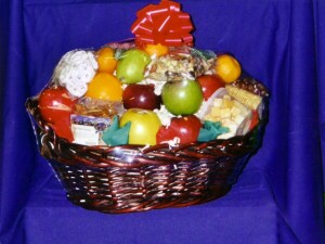 "Fruit Basket #5. The Office/Professional Basket $75-$100 - This basket is packed with ""Thank You's"" & appreciation from you to your employees or professional associates. You tell us how much you want to spend and we will fill the basket with: cheeses, meats, crackers, our own homemade cookies, candies, chocolates, tangerines, clementines, navel oranges, pears, grapes, and of course our own select apples."